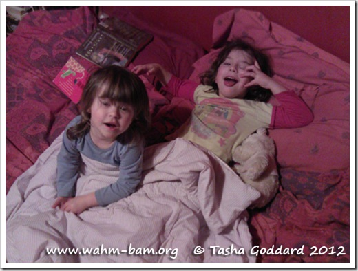 Snuggling up in bed telling stories (www.wahm-bam.org © Tasha Goddard 2012)