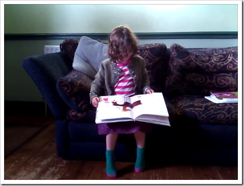 RoRo reading This Moose Belongs To Me by Oliver Jeffers